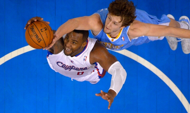 Glen Davis and Jan Vesely battle for basketball