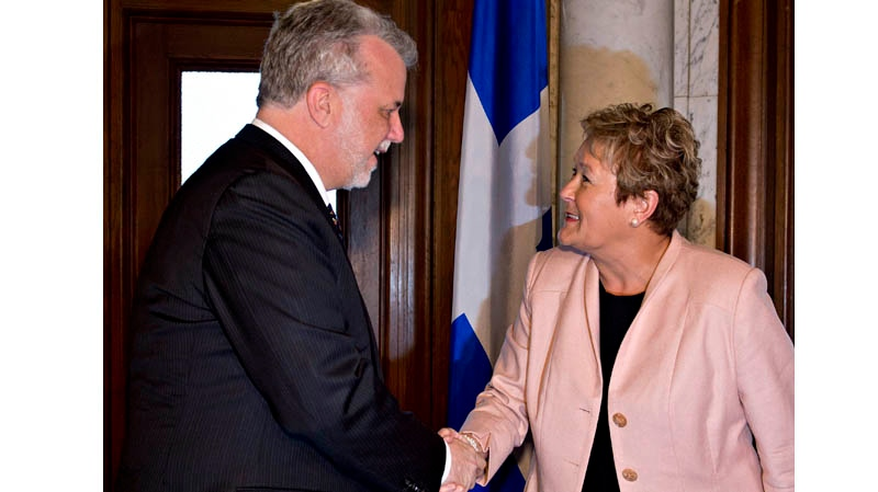 Quebec Premier Pauline Marois, right, welcomes premier designate Philippe Couillard Wednesday, April 16, 2014 at the premier's office in Quebec City to discuss the transfer of power. THE CANADIAN PRESS/Jacques Boissinot
