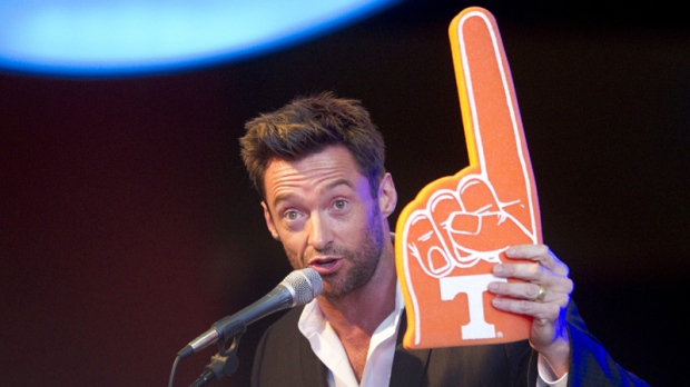 "In this Monday, Oct. 3, 2011 photo, actor Hugh Jackman gets into the Tennessee spirit before a screening of his new movie ""Real Steel"" in Knoxville, Tenn. (AP Photo/Knoxville News Sentinel, Saul Young)"