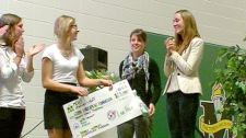Students at Memorial Composite High School in Stony Plain present Amanda Lindhout with a cheque for $23,000 - to go towards her Global Enrichment Foundation. Monday, October 24.