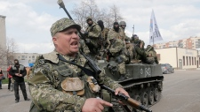 Pro-Russian forces fly flags in eastern Ukraine