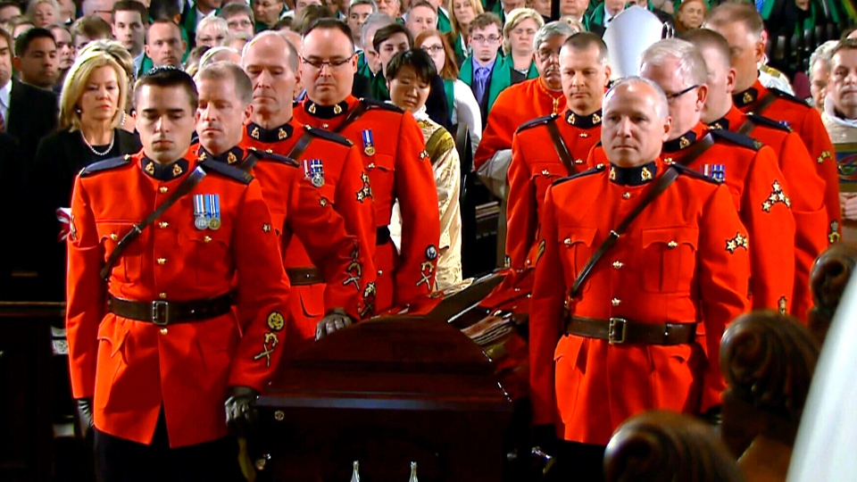 The casket of Jim Flaherty is carried out by RCMP pallbearers at St. James Cathedral in Toronto, Wednesday, April 16, 2014.