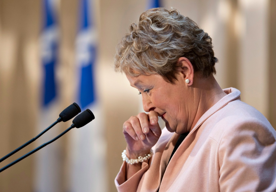 Quebec Premier Pauline Marois looks down and wipes her nose at the end of her last news conference, at the Premier's office in Quebec City, Wednesday, April 16, 2014. (Jacques Boissinot / THE CANADIAN PRESS)