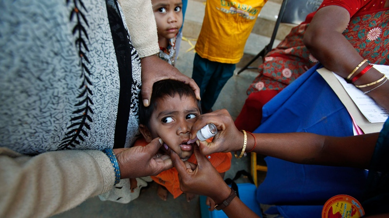 An Indian child is administered polio vaccine during a polio eradication campaign in Bangalore, India, Jan. 23, 2011. (AP / Aijaz Rahi)