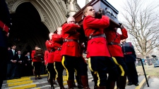 RCMP carry the casket of the late Jim Flaherty