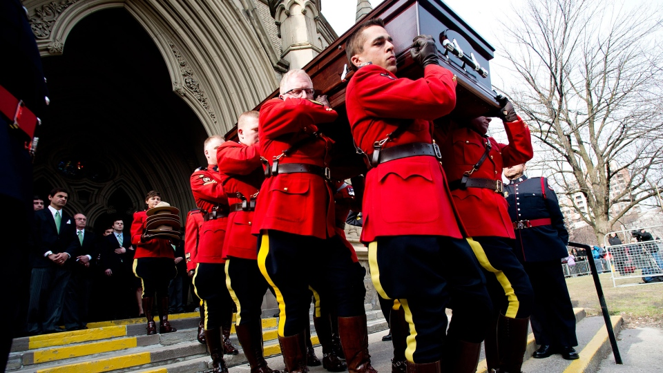 Members of the RCMP carry the casket of the late Jim Flaherty following his state funeral in Toronto on Wednesday, April 16, 2014. (Nathan Denette / THE CANADIAN PRESS)