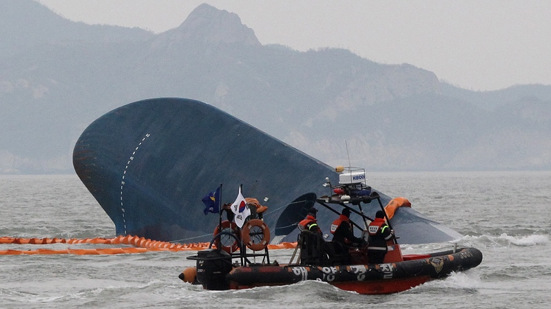 South Korean Coast Guard officers search for missing passengers from a sunken ferry in the water off the southern coast near Jindo, South Korea, Thursday, April 17, 2014. (AP Photo/Ahn Young-joon)