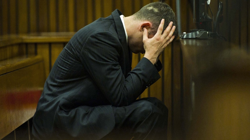 Oscar Pistorius cradles his head in his hands as he listens to forensic evidence being given in court in Pretoria, South Africa, Thursday, April 17, 2014. (AP Photo/Alet Pretorius, Pool)