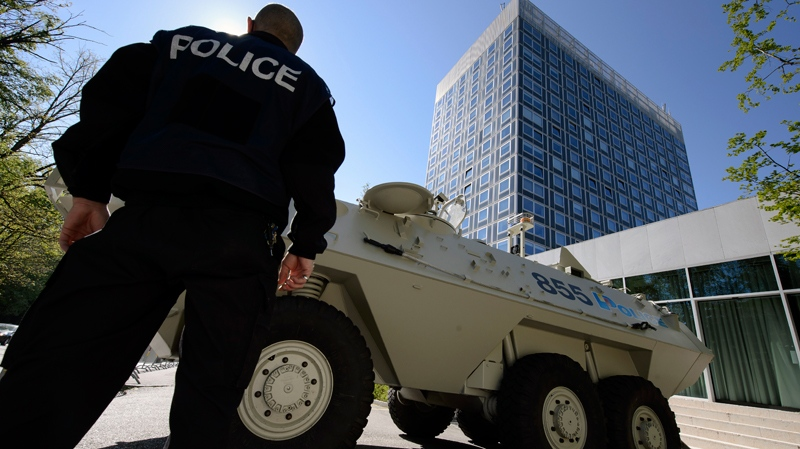 Outside the Geneva, Switzerland hotel where a meeting of the United States, Ukraine, Russia and the European Union is taking place to discuss the ongoing situation in and around the Ukraine on Thursday, April 17, 2014. (AP Photo/Keystone, Martial Trezzini)