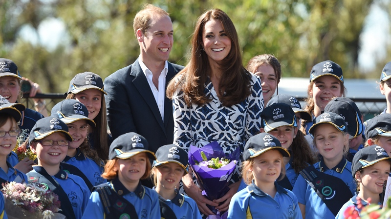 Prince William, centre left, and the Duchess of Cambridge pose for a photo near where a tree is planted at a Girl Guide hall at Winmalee, Australia, Thursday, April 17, 2014. (AP Photo/William West, Pool)