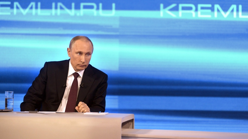 Russian President Vladimir Putin listens during a nationally televised question-and-answer session in Moscow on Thursday, April 17, 2014. (RIA Novosti /  Alexei Nikolsky, Presidential Press Service)