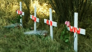 Four crosses mark the spot where Matt Deller, 16, Tanner Hildebrand, 15, Vincent Stover, 16, and Walter Borden-Wilkens, 15, were killed in a car crash in Grande Prairie, Alta., on Monday, Oct. 24, 2011.