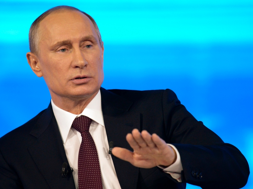 Russian President Vladimir Putin speaks at a nationally televised question-and-answer session in Moscow, Thursday, April 17, 2014. (RIA-Novosti, Alexei Nikolsky, Presidential Press Service)