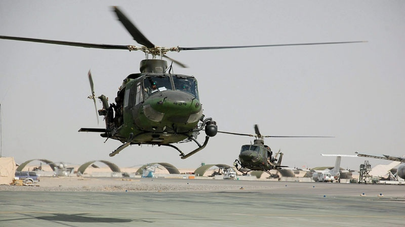 Two CH-146 Griffon helicopters are seen landing at Kandahar Airfield on Feb. 20, 2009. (Murray Brewster / THE CANADIAN PRESS)