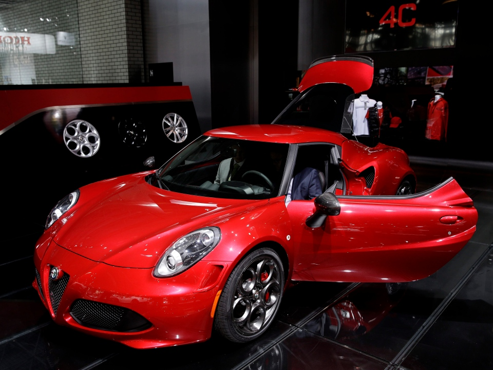 An Alfa Romeo 4C is displayed at the New York International Auto Show in New York, Thursday, April 17, 2014. (AP Photo/Seth Wenig)
