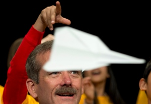 Retired Canadian astronaut Colonel Chris Hadfield takes part in a paper airplane toss with some 60 grade five students in Coquitlam, B.C. Thursday, April 17, 2014. (Jonathan Hayward / THE CANADIAN PRESS)