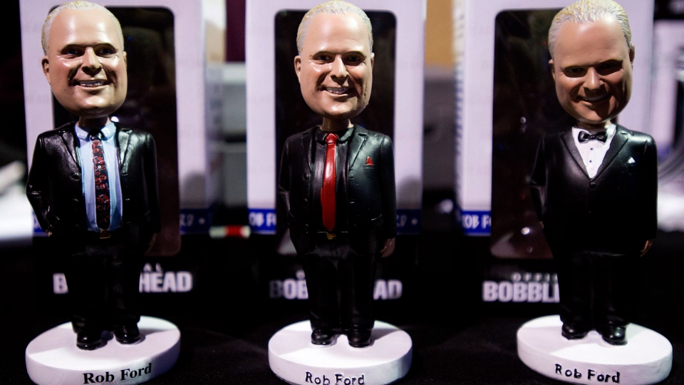 Rob Ford bobble heads are on display for sale as Toronto mayor Ford launches his re-election campaign in Toronto on Thursday, April 17, 2014. (Nathan Denette / THE CANADIAN PRESS)