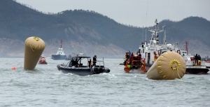 Probe into South Korea ferry focuses on sharp turn, slow evacuation
