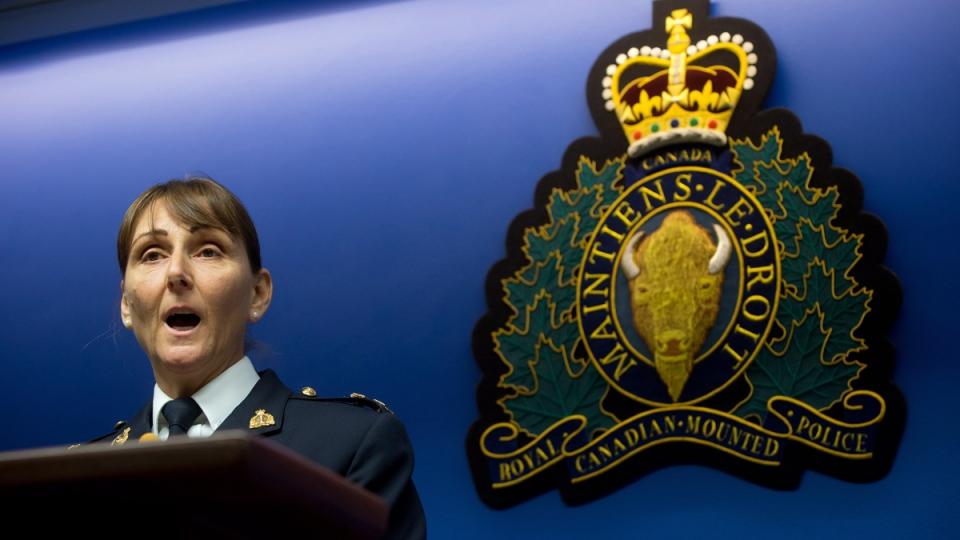 RCMP Insp. Paulette Freill reads a statement during a news conference in regards to charges against a Dutch man in relation to the death of Amanda Todd, in Surrey, B.C., on Thursday April 17, 2014. (THE CANADIAN PRESS/Darryl Dyck)