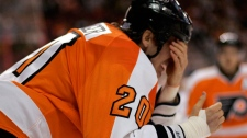 Philadelphia Flyers captain Chris Pronger puts his hand over his eyes as he heads for the locker room after being struck in the face with a stick during the first period of an NHL hockey game with the Toronto Maple Leafs, Monday, Oct. 24, 2011, in Philadelphia. (AP / Tom Mihalek)