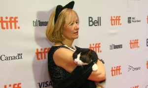 Laureen Harper holds a cat as she poses for photos at the 'Just for Cats' Internet video festival in Toronto on Thursday, April 18, 2014.