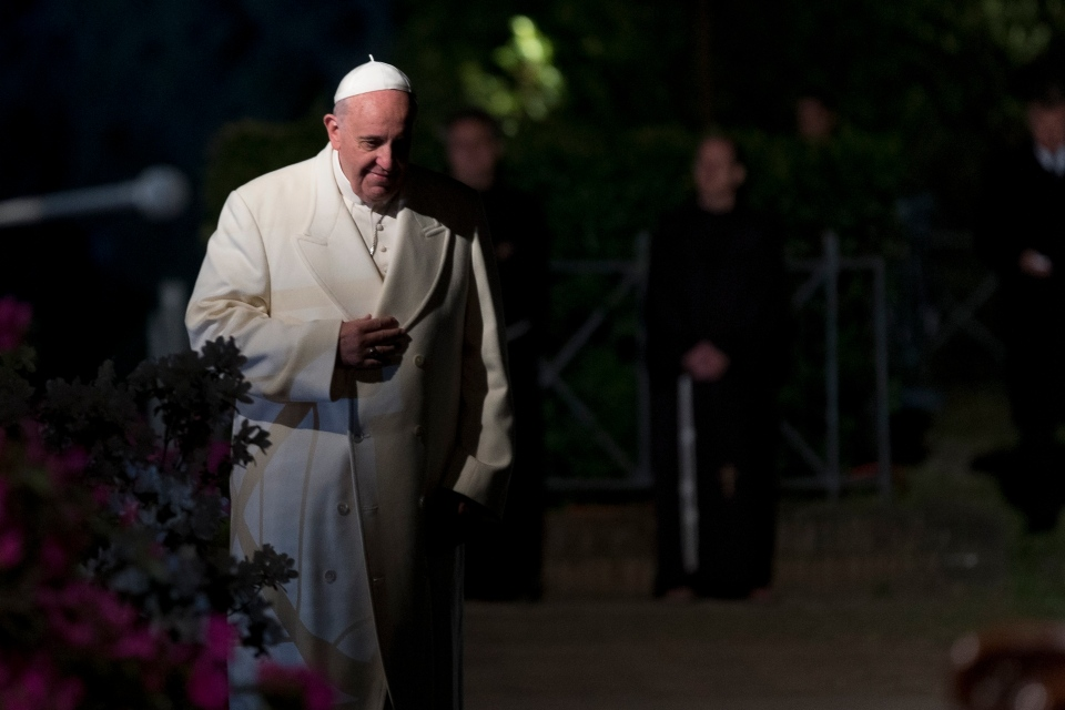 Pope Francis arrives for the Via Crucis torchlight procession to be celebrated in front of the Colosseum in Rome, Friday, April 18, 2014. (AP / Alessandra Tarantino)