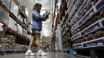 This Sept. 2, 2011 file photo, shows a shopper reading a product label at Costco Wholesale in Mountain View, Calif. (AP Photo/Paul Sakuma, File)