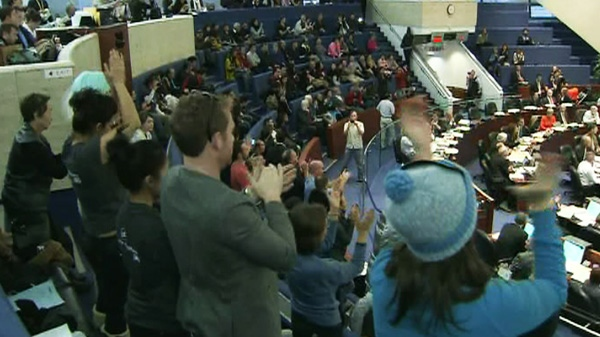 People applaud after Toronto city council voted in favour of banning shark fin products on Tuesday, Oct. 25, 2011.