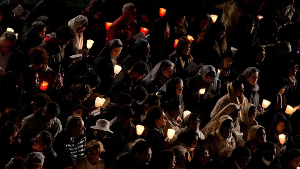 Faithful and nuns attend the Via Crucis (Way of the Cross) torchlight procession in Rome, Friday, April 18, 2014. (AP / Alessandra Tarantino)