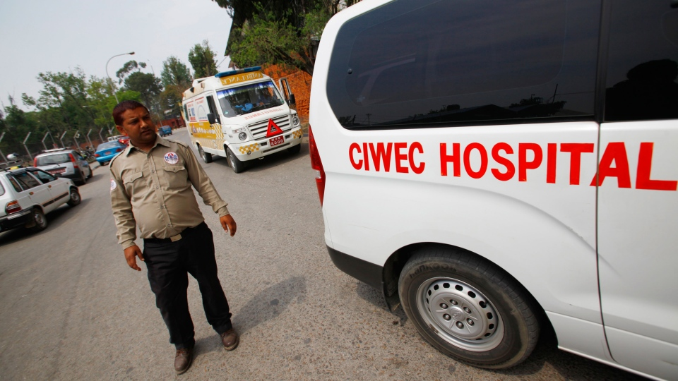 Ambulances are seen waiting outside the Domestic Airport, waiting for injured people of avalanche to arrive, in Katmandu, Nepal, Friday, April 18, 2014. (AP / Niranjan Shrestha)