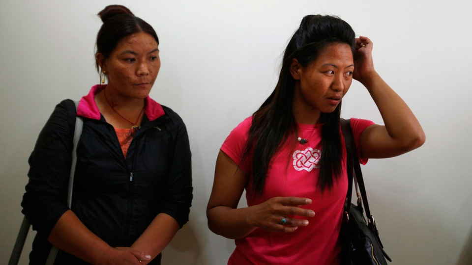 Dawa Yangzum, right, a relative of Nepalese Sherpa Dawa Tashi, who was injured during an avalanche, waits at a hospital in Katmandu, Nepal, Friday, April 18, 2014. (AP / Niranjan Shrestha)
