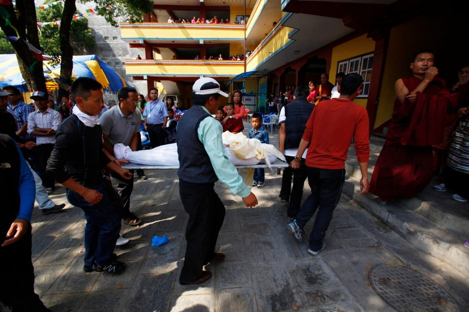 The body of Nepalese mountaineer Ang Kaji Sherpa, killed in an avalanche on Mount Everest, is carried to the Sherpa Monastery in Katmandu, Nepal, Saturday, April 19, 2014. (AP / Niranjan Shrestha)