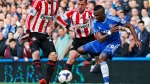 Chelsea's Samuel Eto'o, right, fights for the ball with Sunderland players during an English Premier League soccer match at the Stamford Bridge ground in London, Saturday, April 19, 2014. Sunderland won the match 2-1.(AP Photo/Lefteris Pitarakis)