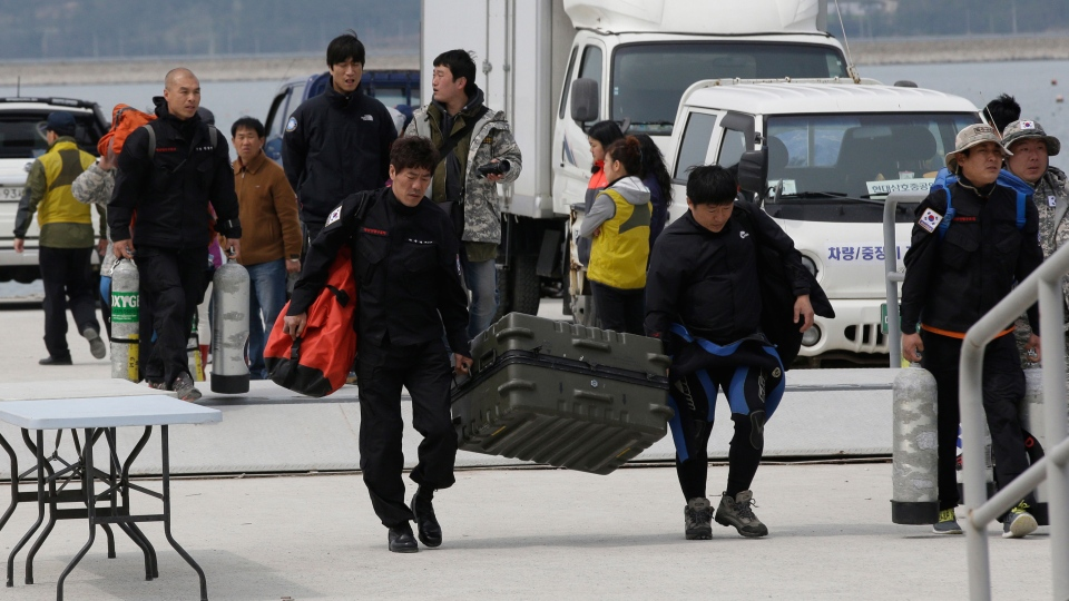 South Korean divers arrive back from their mission to search passengers believed to have been trapped in the sunken ferry Sewol, at a port in Jindo, south of Seoul, South Korea, Saturday, April 19, 2014. (AP / Lee Jin-man)