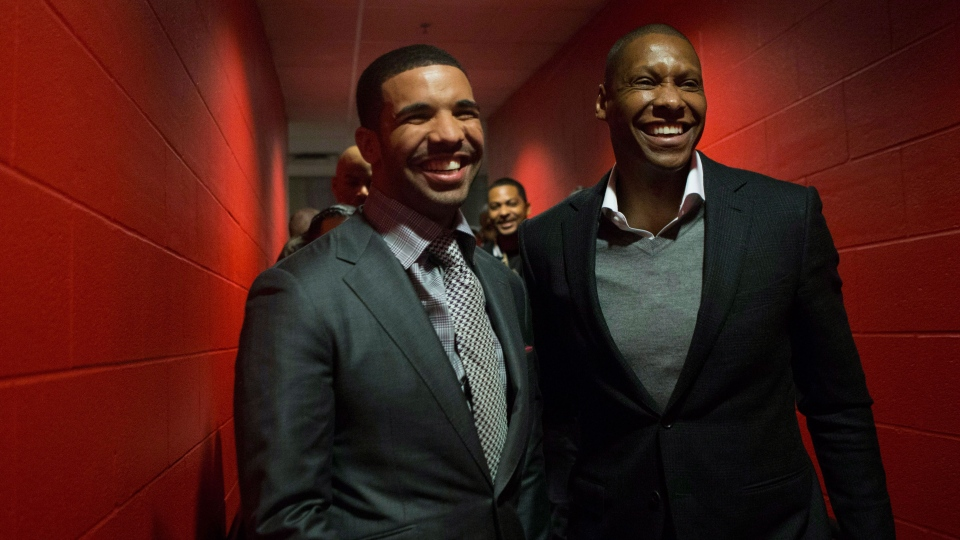 Hip Hop Star and MLSE ambassador Drake (left) chats with Toronto Raptors general manager Masai Ujiri following a press conference before the Toronto Raptors' NBA game against the Brooklyn Nets in Toronto on Saturday, Jan. 11, 2014. (Chris Young / THE CANADIAN PRESS)