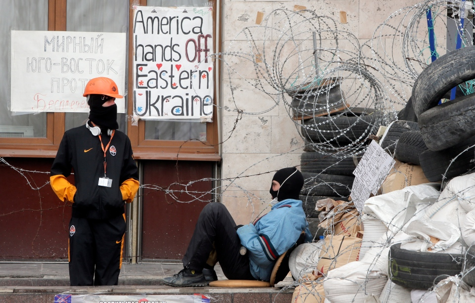 Masked pro-Russian activists guard a barricade at the regional administration building that they had seized earlier in Donetsk, Ukraine, Saturday, April 19, 2014.  (AP / Efrem Lukatsky)