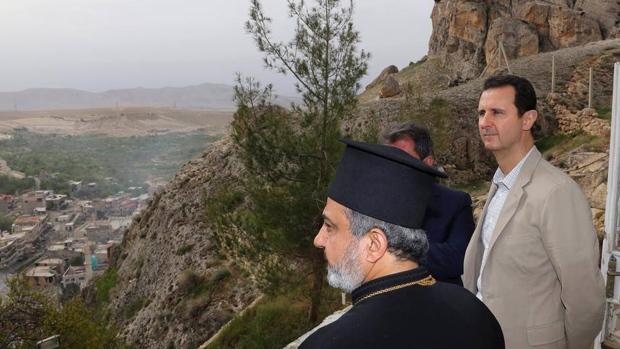 Assad tours Christian village