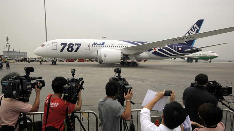 An All Nippon Airways Boeing 787 lands after its inaugural commercial flight from Japan, at Hong Kong International Airport on Wednesday, Oct. 26, 2011. (AP Photo/Vincent Yu)