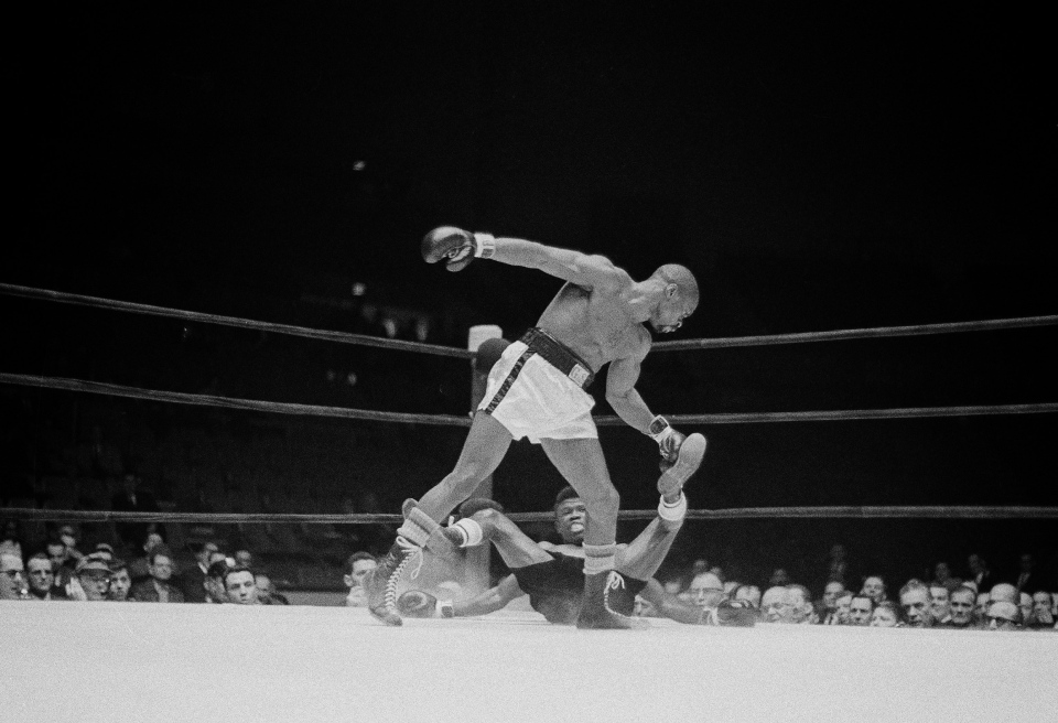 Rubin 'Hurricane' Carter stands over welterweight champion Emile Griffith after a first round punch, in Pittsburgh, Pa., on Dec. 20, 1963. (AP Photo)