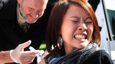 Sue Vang grimaces as she gets a flu shot from pharmacist Patrick O' Neill, during a health fair outside the Capitol in Sacramento, Calif., Wednesday, Oct. 26, 2011. (AP / Rich Pedroncelli)
