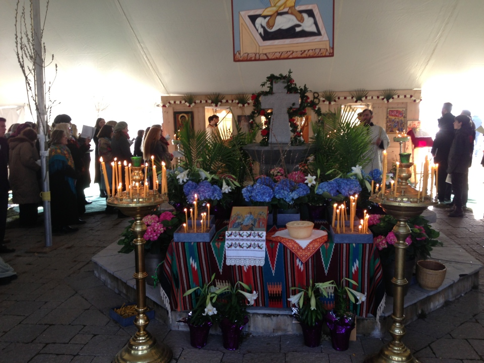 Candles and flowers adorn a makeshift altar as worshippers from St. Elias the Prophet Ukrainian Catholic Church take part in Easter service. (George Stamou / CTV Toronto)