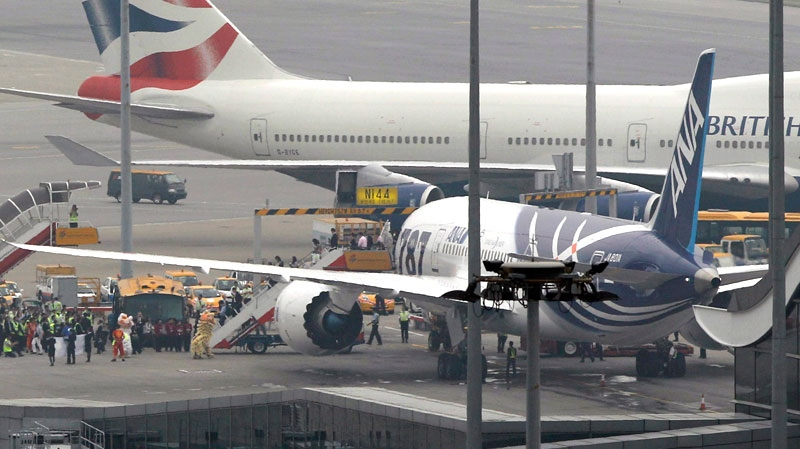 Passengers walk down the stair of an All Nippon Airways Boeing 787 after landing in Hong Kong International Airport for the airplane's inaugural commercial flight from Japan, Wednesday, Oct. 26, 2011. (AP / Kin Cheung)