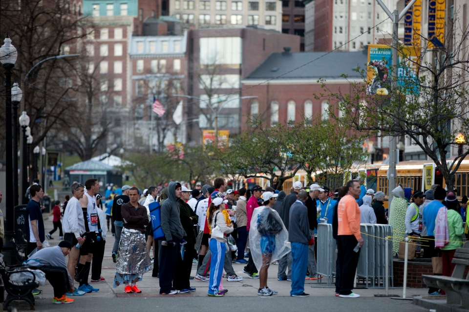 Runners cue to board busses ahead of the 118th Boston Marathon Monday, April 21, 2014. (AP / Matt Rourke)