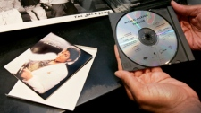 A customer inspects a used CD of Michael Jackson's 'Thriller' that she purchased at a used CD and record store in Berkeley, Calif., June 26, 2009. (AP / Paul Sakuma)