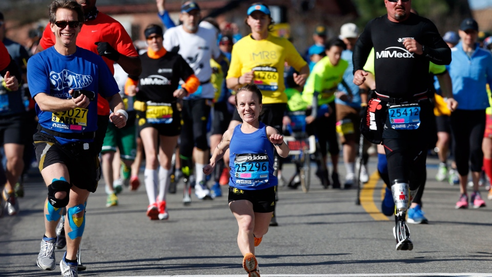 Mobility-impared runners David Abel, left, Juli Windsor, and Scott Rigsby compete in the 118th Boston Marathon Monday, April 21, 2014 in Hopkinton, Mass. (AP  / Michael Dwyer)