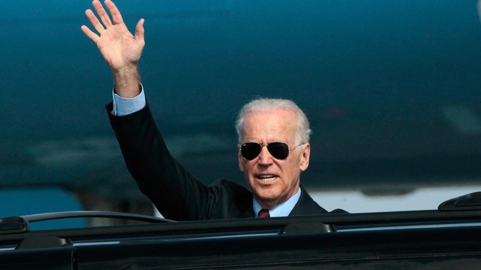 U.S. Vice President Joe Biden waves as he arrives at Borispol airport outside Kyiv, Ukraine on Monday, April 21, 2014. (AP / Sergei Chuzavkov)