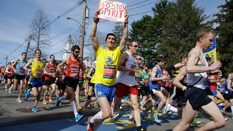 Runners in the first wave of 9,000 cross the start line of the 118th Boston Marathon, in Hopkinton, Mass., Monday, April 21, 2014. (AP / Stephan Savoia)