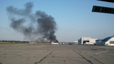 MyNews contributor Stephen Van Dolder shared this photo of a plane crash near Vancouver International Airport on Thursday, Oct. 27, 2011. (Stephen Van Dolder / MyNews.CTV.ca)
