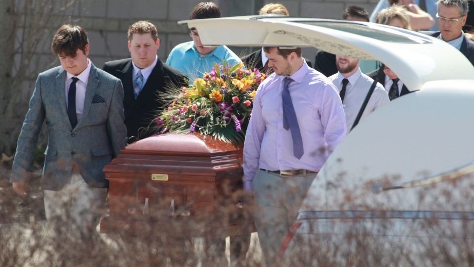 Pallbearers carry the casket of stabbing victim Kaiti Perras to the hearse at her funeral in Calgary on Monday April 21, 2014. (Mike Ridewood / THE CANADIAN PRESS)