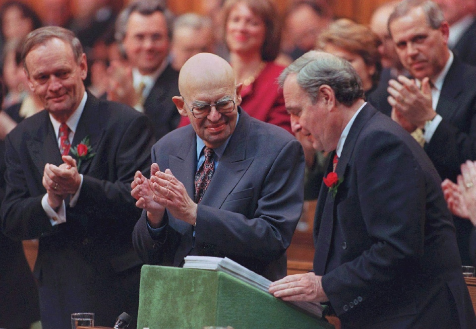 Then-Prime Minister Jean Chretien and Solicitor General, Herb Gray (centre) applaud Finance Minister Paul Martin as he delivers his budget speech in the House of Commons. (Fred Chartrand / THE CANADIAN PRESS)